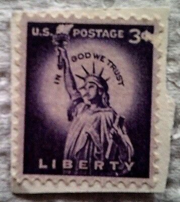 1954 Scott 1035 U. S. Statue of Liberty one used 3 cent stamp on paper