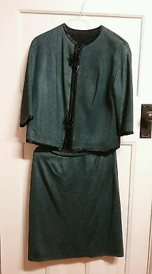 1960s two piece   womens suit.Grey/blue colour with black flex.Size 12.