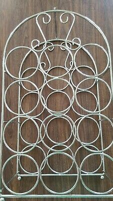 Freestanding Silver metal wine rack holds 12 bottles of wine