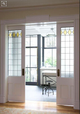 Pocket Doors with  Heritage  Leaded Glass panels  Wow