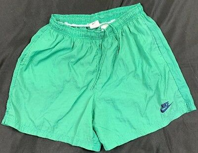 3983e25dd38 VTG 90s Nike Swim Trunks Surfing Board Shorts Youth SZ 18-20 Green Spell Out