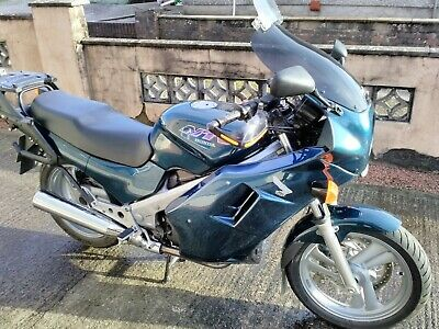 Honda NTV 650. Full fairing, Givi wing rack + panniers and very low mileage.