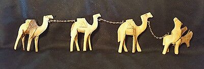 Hand Carved set of wooden camels and donkey