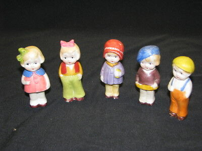 Five antique porcelain kewpie dolls...Excellent and very old!