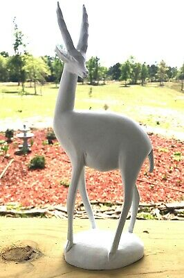 Wood white wild animal shy gazelle looking left vintage