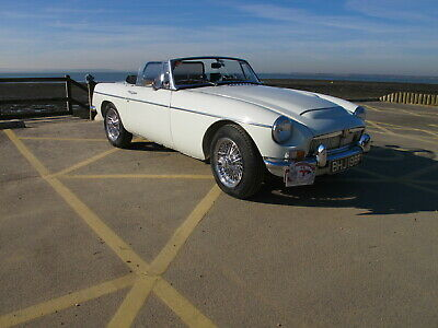 Stunning MGC Roadster in Snowberry White / Red Interior, sitting on Chrome wires