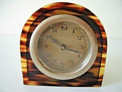 A Small Mechanical , Bedside Clock With Celluloid , Faux Tortoise-Shell Case