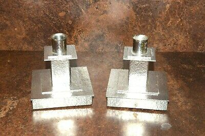 Pair of hammered pewter arts and crafts style candlesticks
