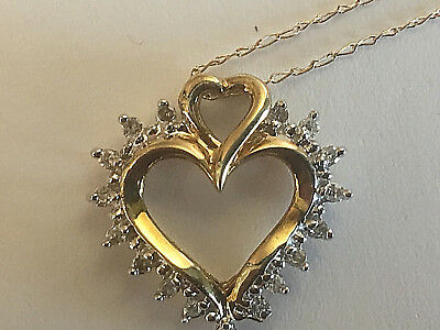 """14 K.Yellow Gold Diamond Heart pendant with 0.15CT.Total  and18"""" chain."""