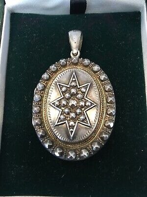 Antique Victorian Decorative Sterling Silver Oval Locket With Star Motif