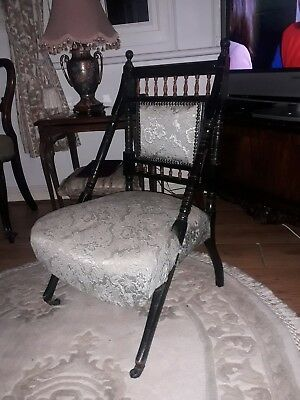 An Edwardian Ebonised Upolstered Chair