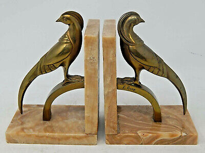 "COLLECTORS: A Pair of RARE French Art Deco Brass Bookends signed ""E. GUY"""