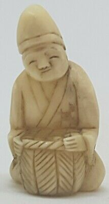 GOOD ANTIQUE JAPANESE CARVED BOVINE NETSUKE OF A SEATED MAN 19th CENTURY