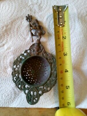 Antique Brass Tea Strainer ornate lion made in Italy.