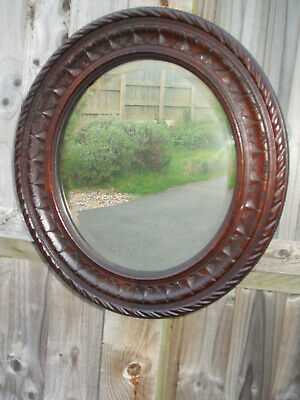 "Antique carved oak oval wall mirror, Arts and Crafts period, useful 18"" high"