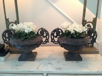 Pair of french antique urns cast metal. Treated/  not painted.