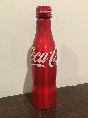 One (1) Metal Coca-Cola Replica Bottle from 2015