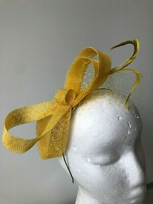 NEW Yellow sinamay loop fascinator with feathers and netting on a silver metal h