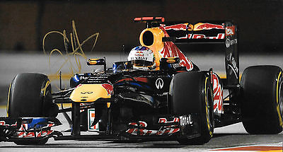 Sebastian Vettel SIGNED 12x8, F1 Red Bull R7 , Singapore GP  2011