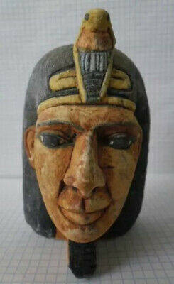Ancient fragment of a statue of stone Pharaoh of Egypt.