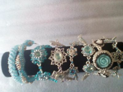8 Aqua  bracelets in 8 designs all Hand Crafted