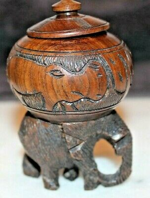Good Looking Vintage Hand Carved Hardwood Pot Of An Elephant carrying A Pot.