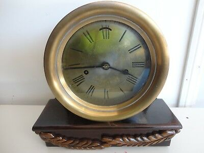 Antique ships clock-brass porthole clock mounted for table or mantle