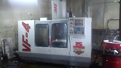 Haas VF-4 vertical mill in use under power