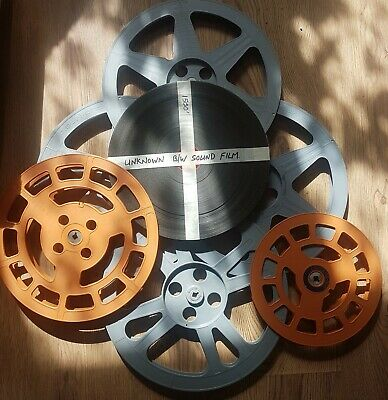 Box Of Spare 16Mm Reels Plus A Film On Core Various Size Spools