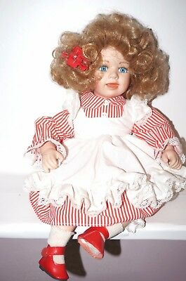 """Collections Etc Collectible Sitting porcelain doll  2002 14"""" tall"""