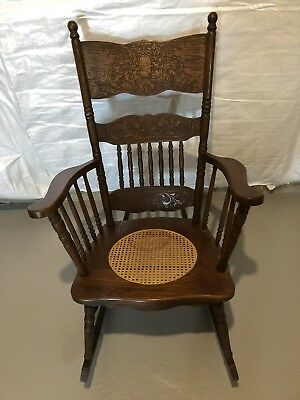 ANTIQUE VICTORIAN oak pressed back rocking chair with cane seat!  BEAUTIFUL!!