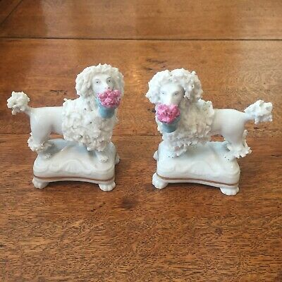 Pair of Antique French, Samson Porcelain Poodles carrying baskets of flowers