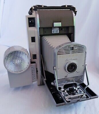 Polaroid Land Camera 800 with case, flash and shutter.