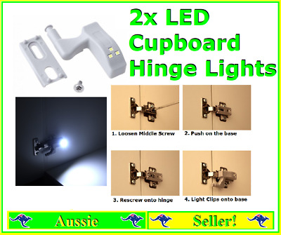 2x Led Cupboard Pantry Hinge Lights Fixes to most standard hinges White Light