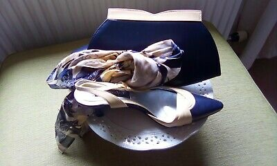 Matching clutch bag. shoes and scarf from Jacques Vert