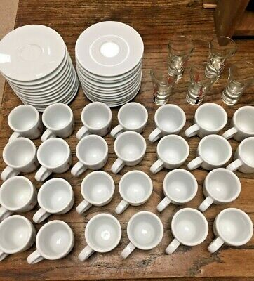 A Large Quantity of Kimbo Espresso Demi Tasse Cups Saucers and Glasses