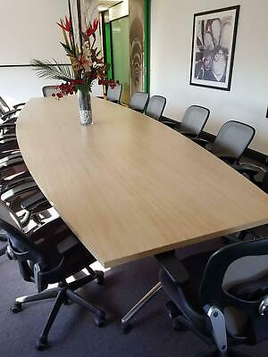 Boardroom table seats 14 in style, no scratches, splits in two