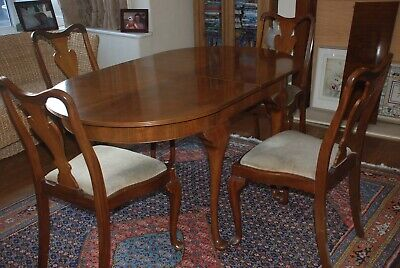 Walnut Extending Dining table, chairs and sideboard
