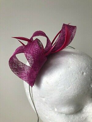 New magenta/purple loop fascinator with biot feathers on a silver metal headband