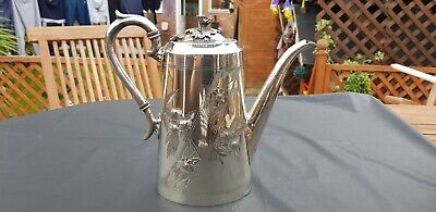 An Antique Silver Plated Tea Pot With Respoused Patterns By James Deakin & Sons.