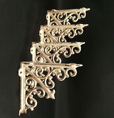 Vintage French corner brackets. Antique white with distressing. Cast iron. two p