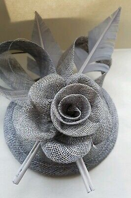 Beautiful Grey feather & flower design facinator wedding