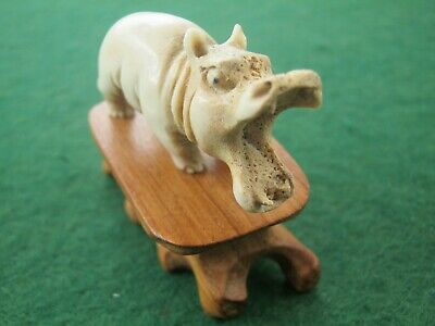 A Sweet Hand Carved Statue Of Yawning Hippo On Wooden Stand In Deer Bone Antler
