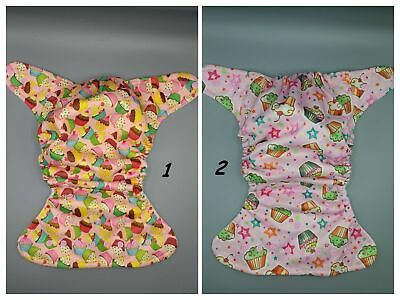 SassyCloth one size pocket cloth diaper with cupcakes on pink PUL print.