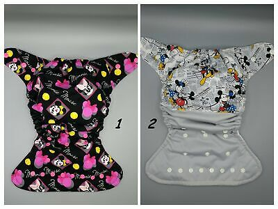 SassyCloth one size pocket diaper with cartoon Mouse cotton print.