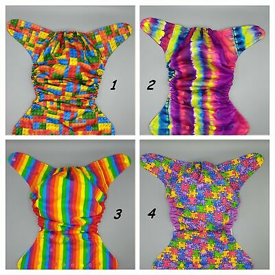 Cloth diaper SassyCloth one size pocket diaper with rainbow and puzzle print.