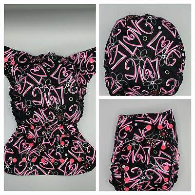 SassyCloth one size pocket diaper with hot pink LOVE on black cotton print. Read