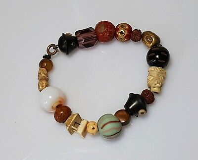 A Bracelet Comprising Of A Number of Meiji Period Ojime beads.