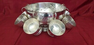 A Beautiful antique Silver Plated Punch Bowl & 6 Cups with respoused patterns.