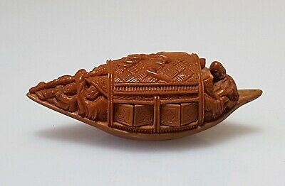 A Fine Quality Inscribed Miniature Olive Stone Carving Of A Boat. Poem & Signed